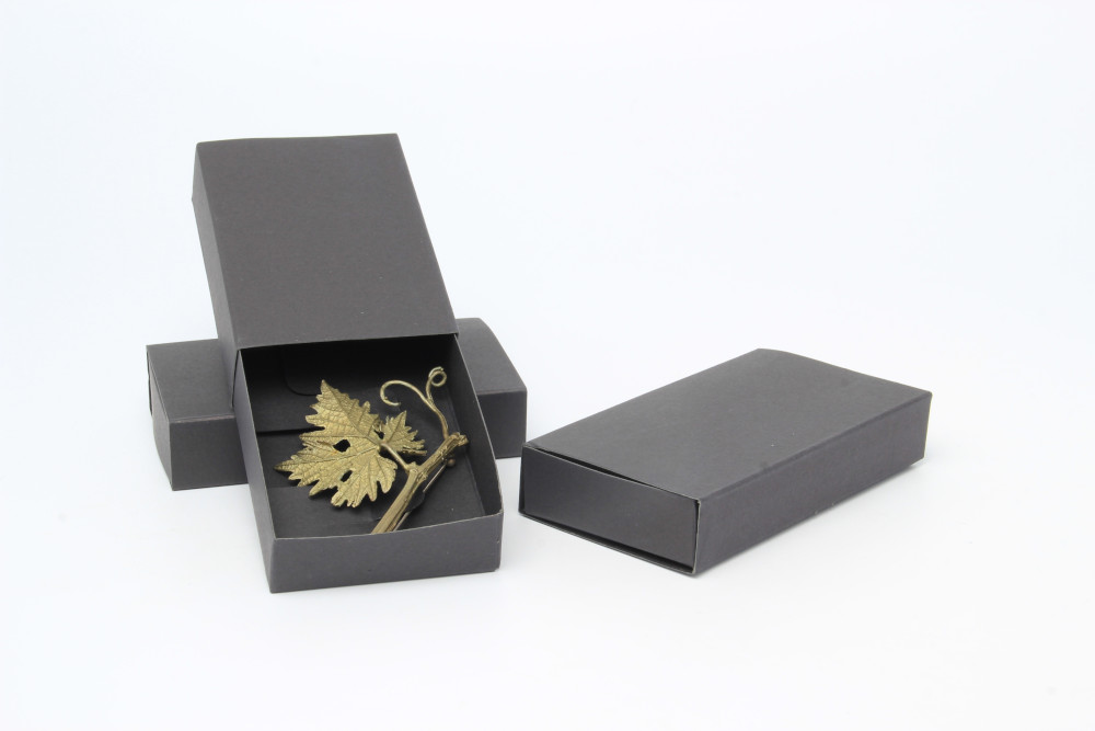 Black matchbox style jewellery box for brooches