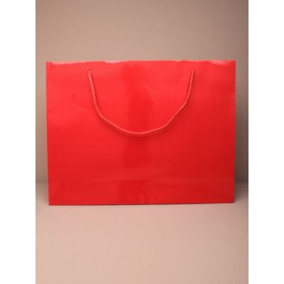 Size: 27.5x36x10cm Glossy red gift bag.