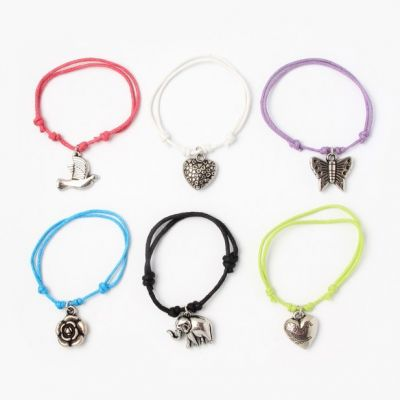 Adjustable corded bracelet with Silv charm.