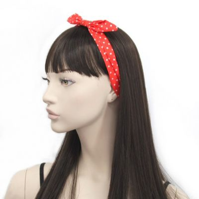 Spotty fabric bandeau with knotted bow.