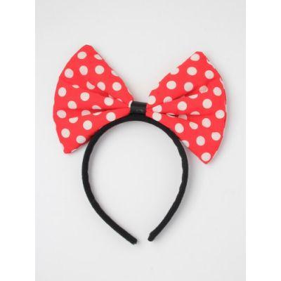 Large polka dot bow on a black aliceband