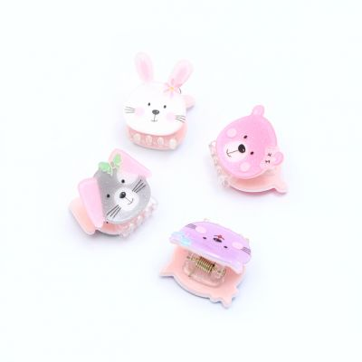 Card of 2 animal face child size clamps. 1.5cm