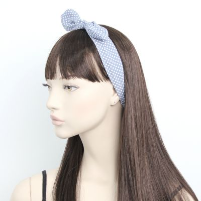 Polka dot fabric bandeau with bow.