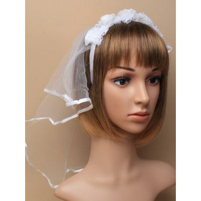 Fabric and lace headdress with veil