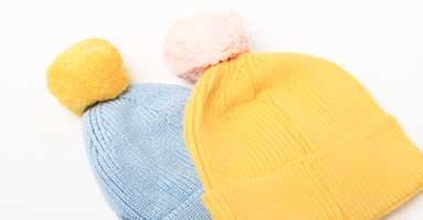 Bobble Hats In Bright Colours With Contrasting Pom Poms